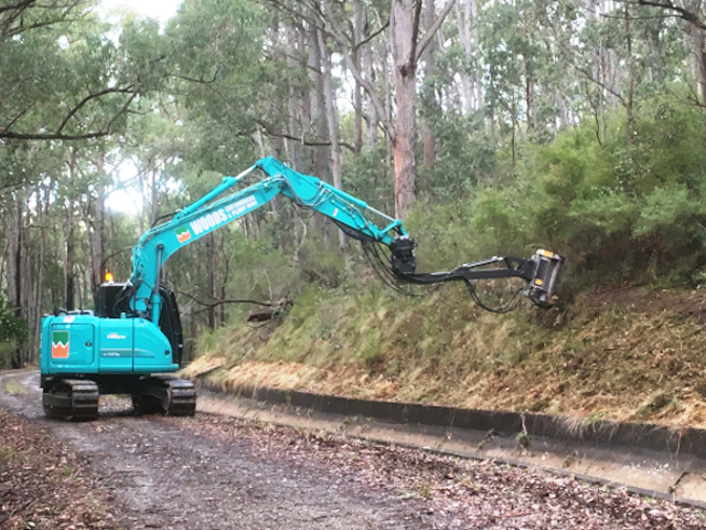 14t Kobelco with mulching attachment